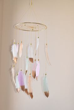 Thanks Brandi!! This beauty is now hanging in the nursery:)) Love<3 Dreamcatcher Mobile Flying Pastel Feathers by BlueDreamcatcher