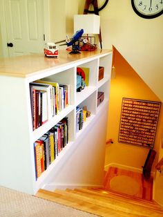 2-sided bookshelf in place of railing at top of stairs in my split foyer home. Maybe not 2-sided, but def. one-sided.