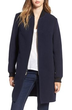 Free shipping and returns on Wayf Elongated Bomber Jacket at Nordstrom.com. A hybrid between a polished coat and a classic bomber, this longline jacket is styled with a slender varsity collar and metallic front zip that leaves an angular notch at the hem when fastened.