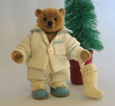 "Paula Strethill-Smith: Christmas Collection. Toddy is 3.5"" high miniature teddy bear created from quality German mohair. Toddy wears warm flannel pj's which are made from  a vintage babies gown.I have trimmed them with vintage french pale blue piping.His matching blue felt slippers are made by ourselves with leather soles and trimmed with silk pom poms. He is patiently waiting for santa with his little antique wool and lace trimmed stocking."