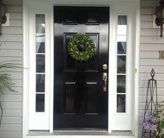 Black gloss door, white trim, light gray siding and maybe a darker stone