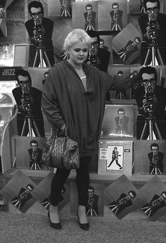 A pre Go-Go's Belinda Carlisle, heavily immersed in the Los Angeles punk scene, stands in front of an Elvis Costello display. Belinda Carlisle, Music Love, Good Music, Elvis Costello, We Will Rock You, Women In Music, Dance With You, Summer Rain, Post Punk