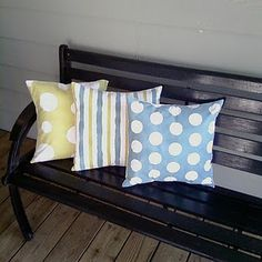 Spray painted pillows.  Will try!!  Could be fun for the playroom, once we get new furniture