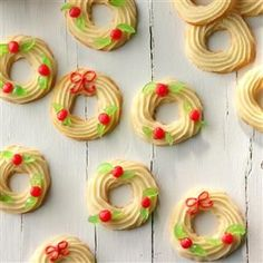 Holly Wreaths Recipe -I've never come across another spritz cookie like this - one calling for cream cheese as an ingredient. That helps to keep these wreaths moist a long time, while also adding a delicious flavor. —Dee Lein, Longmont, Colorado