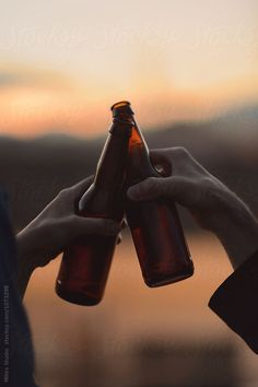 Rooftop Hangout by Milles Studio for Stocksy United. Couple drinking beer on a rooftop