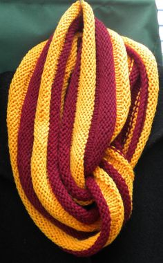 972dc3c94d5 Cowl is hand knit in burgundy and gold 100% Peruvian highland wool. This  hand