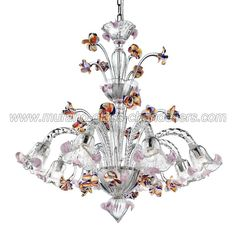 Carnevale 8 lights Murano chandelier with crest transparent polychrome color This incredible Murano glass chandelier is made with multicolor finishes on a clear glass body. The pink pasta decorations give a touch of charm and romance.  It is possible to connect a supplementary LED light on the central part, to make it really unique.  Hand blown glass chandelier made in Italy with genuine Murano glass.