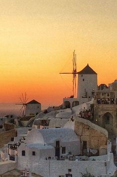 Santorini's beautiful orange sunset from my recent trip to Oia town in Greece complete with windmills