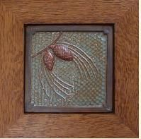 Framed Pine-cone tile with green and copper glaze.  Hand crafted oak frame by Family Woodworks LLC