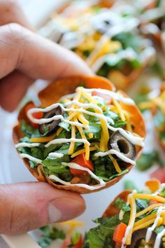 Mini Taco Salad Cups - These cute mini salad bowls are so fun to make, and even more fun to gobble up! Perfect for game day or an easy dinner for the kids!