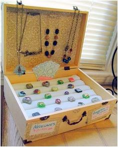 Repurposed suitcase holds jewelry.