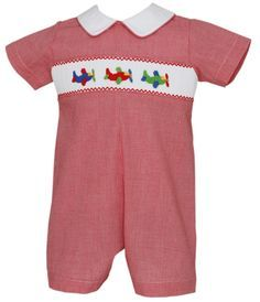 Red microcheck straight bubble for baby and toddler boys with smocked airplanes in primary colors and white collar. Sizes 3 Months to 24 Months. #babyboysclothes #toddlerboysclothes #boys #baby