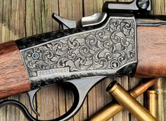 Hand engraved Win 1885 by Ian Morrison. Engraved gun.