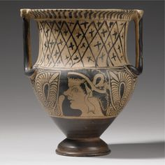 AN ETRUSCAN RED-FIGURED COLUMN KRATER, CIRCA 330-320 B.C. one side of the body decorated with the profile head of a young satyr facing left and wearing a diadem