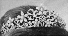 THE OGILVY TIARA: As a young princess, Princess Alexandra of Kent occasionally wore a set of diamond flowers in her hair. Around the time of her engagement to the Hon. Angus Ogilvy, the flowers were turned into a tiara of her very own. The tiara includes a series of those five petal diamond flowers, each one with an interchangeable stone in the center, set in a swirling diamond ribbon structure.