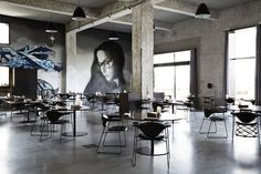 The spacious, graffiti-decorated dining room at Amass.