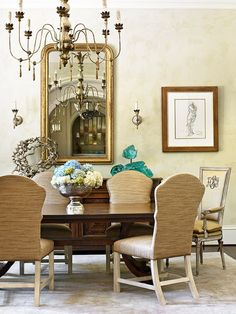 Loving these textural dining chairs and monogrammed antique host/hostess chairs! - Traditional Home® / Photo: Emily Followill / Design: William C. Huff, Jr. and Heather Zarrett Dewberry