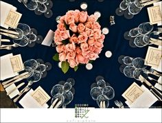 LOVE the soft pink/peach rose contrasted against navy tablecloth. Perfect representation of our wedding colors on tables.