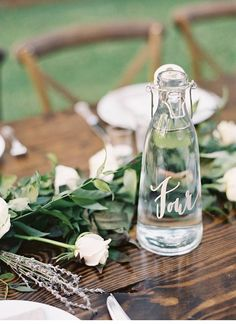 Calligraphed water bottles for table numbers