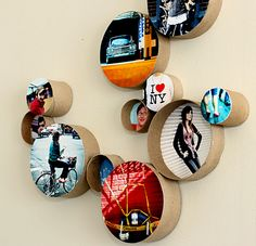 cardboard tubes - cool effect, cool display. Put any picture in a tube and mount it on the wall DIY