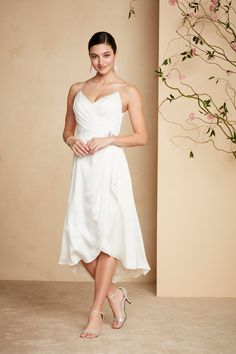 This slinky v-neck short wedding dress is perfect for a city hall wedding or the rehearsal dinner! Shop this DB Studio casual wedding dress and more only at David's Bridal