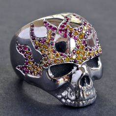 Skull ring with hot rod flames- platinum, yellow diamonds, and rubies by Crazy pig designs.