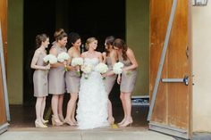 Taupe colored brides maids dress to keep with the neutral colors of the winery.   Read More: http://www.loveandlavender.com/2014/06/montaluce-winery-wedding/