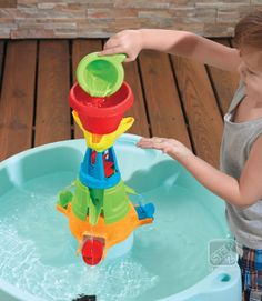 Watch the chain reaction as water is poured through the center funnel and filtered into various outlets on the Step2 Water Works Water Table #water #play