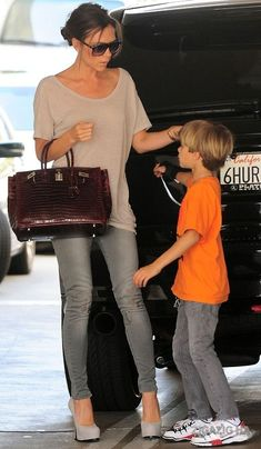 Victoria Beckham | hair in a bun + casual t-shirt (a little big) + skinny jeans + high heel pumps