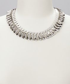 Shimmering embellishments surround the entirety of this necklace creating a collar piece that can't be forgotten. Edgy and elegantly contrasting, this piece is easy to dress up or dress down.
