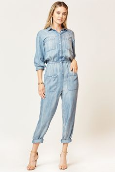 An effortless pull-on jumpsuit, finished with a basic collar, front pockets, and an elastic waist detail. it's a laid-back way to do pretty. Machine wash cold, hang to dry. Runs true to size. Denim Playsuit, Playsuit Romper, Classy Jumpsuits For Weddings, Curvy Women Fashion, Womens Fashion, Ladies Fashion, Casual Outfits, Fashion Outfits, Shorts