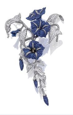 """Sapphire and diamond """"Convolvolo"""" brooch, Michele Della Valle. Designed as a flowering branch of convolvulus, set with circular-cut sapphires and brilliant-cut diamonds, mounted in white gold and titanium, signed Michele della Valle and numbered, Italian assay and maker's marks."""