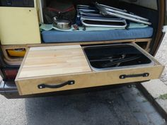 The rear pull out stove