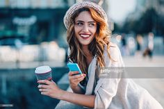 Stock Photo : Smiling woman at urban scene