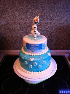 Frozen themed cake - Olaf sculpted out of fondant/gum paste mixture & I gave him an extra snowball on top to kick :)