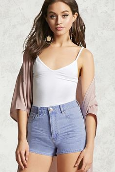 A pair of denim shorts featuring a high waist, whiskering on the front, five-pocket construction, zip fly, and a vented hem.