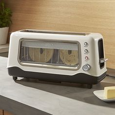 Dash ® Clearly Better White Toaster   Crate and Barrel
