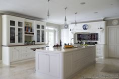 floors for white cupboards   Curved cabinet ends and conical pendant lights give this kitchen a ...