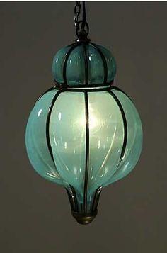beautiful blown glass lantern. Love the color, like sea glass. - http://www.homedecoras.net/beautiful-blown-glass-lantern-love-the-color-like-sea-glass
