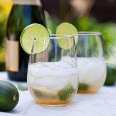 Champagne Mimosa      fresh mint- 1 sprig  1 tablespoon lime juice  1/2 to 1 tablespoon turbinado sugar ( adjust to sugar content of champagne)  ice  champagne or sparkling wine