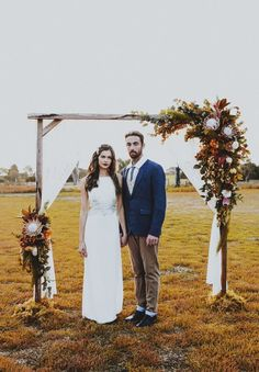 27 Fall Wedding Arches That Will Make You Say 'I Do!': Moody arch with g… 27 Fall Wedding Arches That Will Make You Say 'I Do!': Moody arch with greenery, leaves and flowers