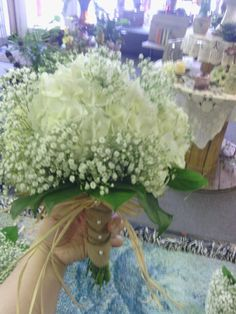 Jill's wedding bouquet; rustic chic hydrangea with babys breath with burlap and raffia accents.