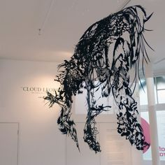 Cloud Leopard by Nahoko Kojima. Finely cut from a single sheet of paper, it represents five months of work
