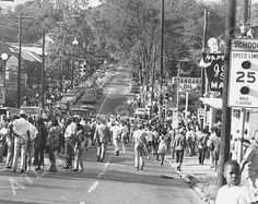This photo features a view of a crowd of people on Ormand Street in the Summerhill neighborhood of Atlanta. Police shot and killed a suspected car thief, which played as yet another instance of police brutality among African Americans. Following the shooting, several thousand people took to the streets for four days of unrest. The Student Nonviolent Coordinating Committee (SNCC) and its leader Stokely Carmichael were accused of inciting the unrest, September 6, 1966.  Photo credit: Atlanta…