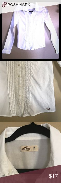 Hollister white button down shirt size medium NWOT Crisp white button down shirt from Hollister this cute shirt has a cute ruffle detail on the front. Size medium brand  new without tags Hollister Tops Button Down Shirts