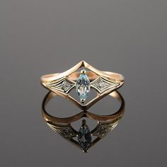 Art deco ring, Topaz ring, Geometric ring, Promise ring, 14k gold ring, Antique ring, Modern ring, Everyday ring, Rose gold ring  This is a stunning, feminine ring that works well for all occasions, styles, and ages. You will love it!  SHIPPING by Priority Air Mail!  Same ring in white gold: https://www.etsy.com/listing/294832061/topaz-ring-art-deco-ring-gemstone-ring?ref=shop_home_active_1 ▂▂▂▂▂▂▂▂▂▂▂▂▂▂▂▂▂▂ Ring information:  Main stone: Sky Topaz Approximate size: 6*3 mm  Accent stone…