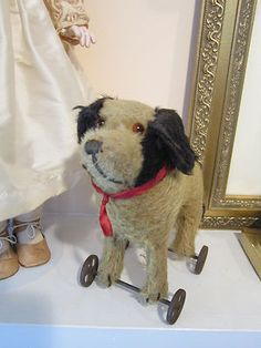 """MOHAIR DOG ON WHEELS ,9"""" LONG  8 1/2 """" TALL EXELENT CONDITION"""