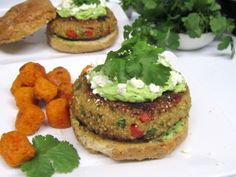Chicken-Quinoa Burgers...3/4 cup uncooked black quinoa (I used regular)  1 lb. ground chicken  1/2 red bell pepper, finely diced  1 cup cilantro leaves, divided in half  1 tsp chili powder  1 tsp cumin  1 tsp ground coriander  1/2 tsp garlic salt  Coarse salt and freshly ground pepper  2 Tbsp extra-virgin olive oil  1 avocado  3 Tbsp plain Greek yogurt  Juice from a lime (about  2 Tbsp)  4 whole wheat buns, toasted  1/4 cup crumbled cotija cheese