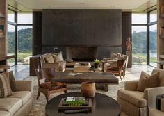 love the seating arrangements and the charcoal grey fireplace wall