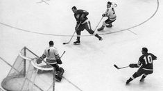 DETROIT, MI - APRIL 2: Gordie Howe #9 of the Detroit Red Wings takes the shot as goalie Glenn Hall #1 of the Chicago Blackhawks makes the save while Howe is being defended by Pierre Pilote #3 of the Blackhawks and Alex Delvecchio #10 of the Red Wings looks for a rebound during Game 4 of the 1964 Stanley Cup Semi Finals on April 2, 1964 at the Detroit Olympia in Detroit, Michigan. (Photo by Bruce Bennett Studios/Getty Images)